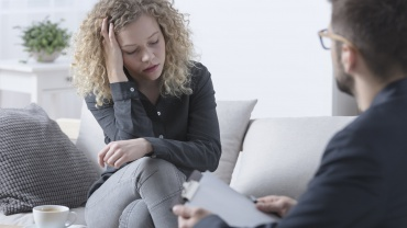Worried woman during psychotherapy